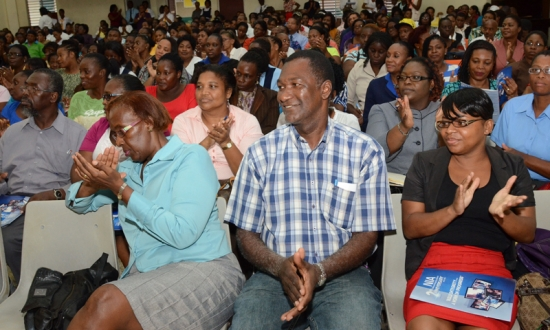 Members of the Parent Body of Alpha HIgh listening attentively