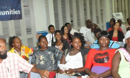 dsc_6332-residents-of-portmore-listen-attentively-as-one-of-their-fellow-citizens-poses-a-question-to-the-panel